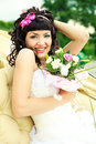 Excited bride with flowers Royalty Free Stock Photo
