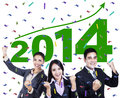 Excited business people celebrating a new year successful with arms up Royalty Free Stock Photography