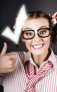 Excited Business Woman With Huge Tick And Thumb Up Royalty Free Stock Photography