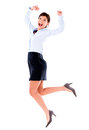 Excited business woman jumping with arms up isolated over white Stock Photography