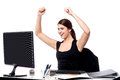 Excited business woman raising her hands young Royalty Free Stock Photo