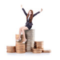Excited business woman sitting on money and raise arms isolated against white background concept Stock Photos