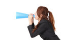 Excited business woman yelling through megaphone Royalty Free Stock Photo