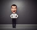 Excited businessman with big head full length picture of over dark background Royalty Free Stock Photo
