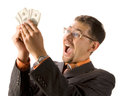 Excited businessman with dollars Royalty Free Stock Photos
