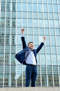 Excited businessman raising his arms happy young celebrating success Royalty Free Stock Photography