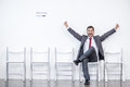 Excited businessman sitting and waiting for interview in office Royalty Free Stock Photo