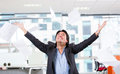 Excited businessman throwing papers Royalty Free Stock Photo