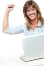 Excited businesswoman celebrating her success Royalty Free Stock Images