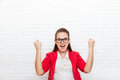 Excited businesswoman hold hands fist up happy smile wear red jacket glasses Royalty Free Stock Photo