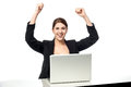 Excited businesswoman raising her arms up successful corporate lady at work desk raised Royalty Free Stock Photography