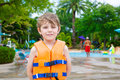 Excited child enjoying summer vacation in water park Royalty Free Stock Photo