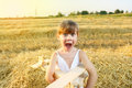 Excited child little girl in the wheat field Stock Images