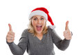 Excited chrismtas woman wearing santa hat giving thumbs up isolated on white background Royalty Free Stock Photos