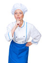 Excited cook showing silence sign Stock Image