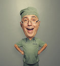 Excited doctor in glasses funny picture of bighead over dark background Royalty Free Stock Images