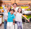 Excited family at a cafeteria Royalty Free Stock Photo