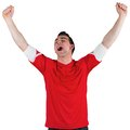 Excited football fan cheering on white background Royalty Free Stock Photo