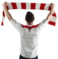 Excited football fan cheering on white background Royalty Free Stock Images