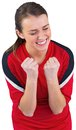 Excited football fan in red cheering on white background Royalty Free Stock Photography