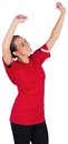 Excited football fan in red cheering on white background Stock Image
