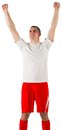 Excited football player cheering on white background Stock Photos