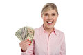 Excited girl holding currency notes fan attractive young dollar Stock Image