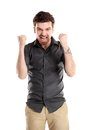 Excited handsome business man arms raised success isolated white Stock Photos