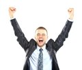 Excited handsome business man with arms raised in success isolated on white Royalty Free Stock Image