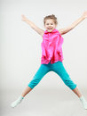 Excited happy little girl kid jumping for joy. Royalty Free Stock Photo