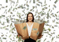 Excited happy woman under dollar s rain businesswoman standing and holding two paper bags Royalty Free Stock Images
