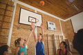 Excited high school kids scoring a goal while playing basketball Royalty Free Stock Photo