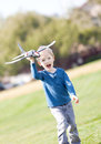 Excited little boy running toy plane Royalty Free Stock Photo