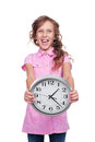Excited little girl showing clock Stock Image