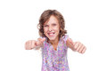 Excited little girl showing thumbs up Royalty Free Stock Image