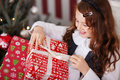 Excited little girl undoing her christmas present high angle view of a beautiful unwrapping untying the decorative ribbon Royalty Free Stock Photography