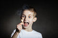 Excited male child yelling with flaming match Royalty Free Stock Photo