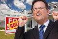 Excited Man in Front of Sold Real Estate Sign Royalty Free Stock Photo