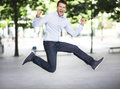 Excited man jumping portrait of young business Stock Photos
