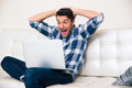 Excited man looking game on laptop Royalty Free Stock Photo