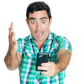 Excited man yelling at his phone Royalty Free Stock Photo