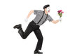 Excited mime artist running with a bouquet of flowers isolated on white background Royalty Free Stock Photos