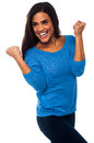 Excited pretty girl with clenched fists happy clenching her in excitement Stock Photos