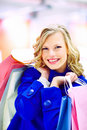 An excited pretty woman holding shopping bags Stock Images