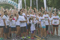 Excited and ready to color run asheville north carolina usa july participants wait impatiently at the starting line for the race Stock Image
