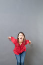 Excited s woman ready to jump to express euphoria success concept or vitality studio shot Royalty Free Stock Images