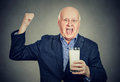 Excited senior gentleman holding a glass of milk Royalty Free Stock Photo