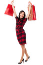 Excited shopping girl having great fun gorgeous young holding bags in her raised arms Stock Photography