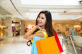 Excited shopping woman holding bags on a in the city Royalty Free Stock Photo