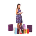 Excited shopping woman looking into bag and get present, Royalty Free Stock Photo